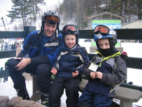 Andy and the kids take a ski break by the fire