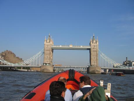 Speedboat beneath Tower Bridge