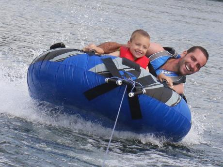 Kris and Mason tubing together