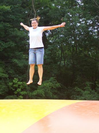 Tricia gets airborne on the Jumping Pillow